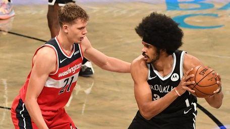 Nets center Jarrett Allen is defended by Wizards