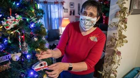 Janet Moskos with her Christmas decorations at her
