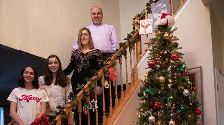 Liz Savitsky with her husband, Michael, and their