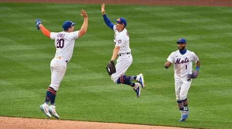 Mets players Pete Alonso, Brandon Nimmo and Amed