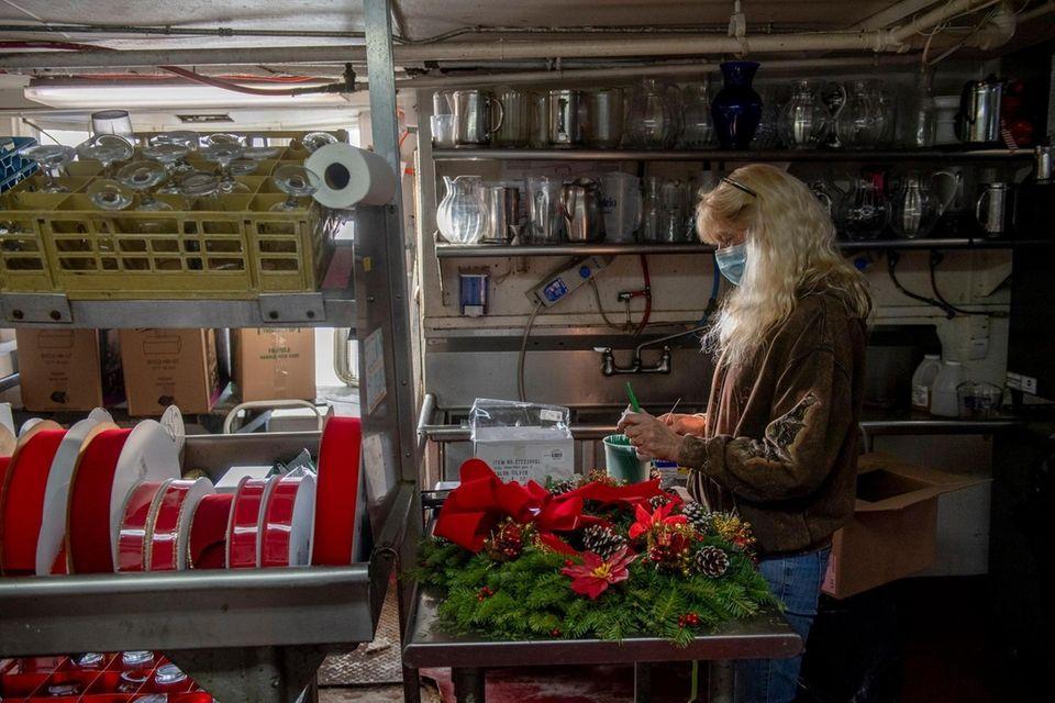 Suzzanne Serino, manager at Duryea's Flower Shop, assembles
