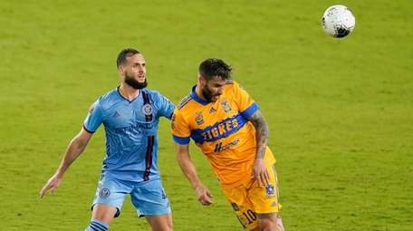 Tigres forward Andre-Pierre Gignac, right, heads the ball