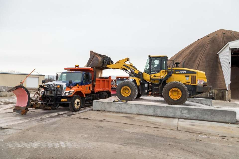 Road sanders and plows are prepped for the