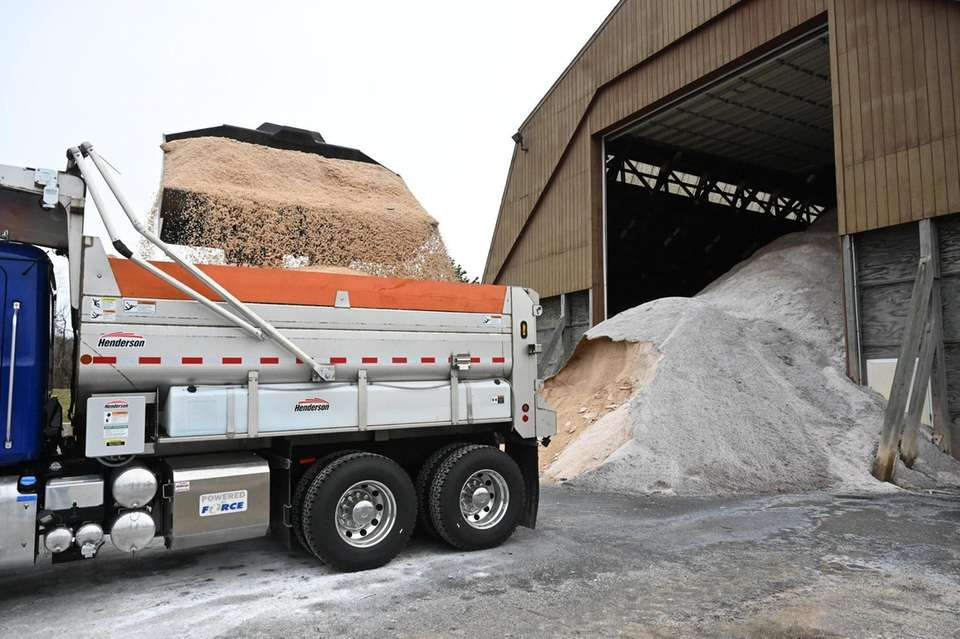 A truck is loaded with salt at the
