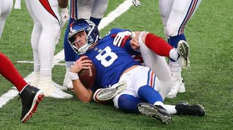 Giants quarterback Daniel Jones after being sacked by
