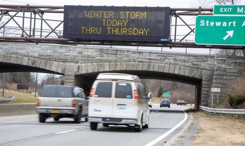 Winter storm warning signs on the northbound Meadowbrook