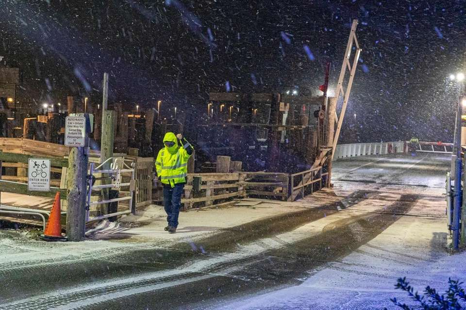 Snow begins to fall in Greenport on Wednesday,