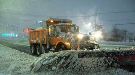 Plows try to keep Old Country Road in