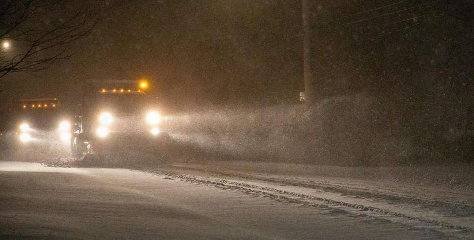 Plows clear snow on Shore Road in Setauket