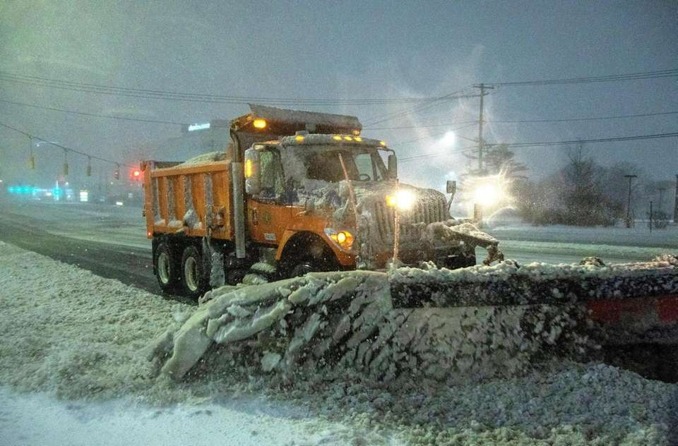 Plows try to keep Old Country Road clear
