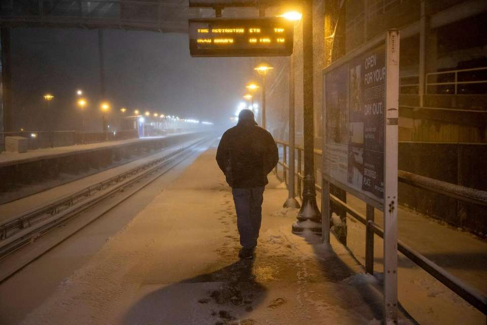 Commuters battle snow covered platforms at the LIRR