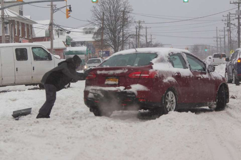 Glen Cove resident helps as he pushes a