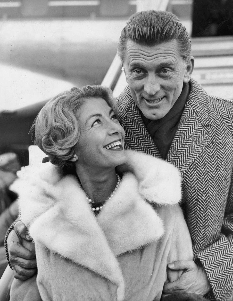 5th December 1960: Kirk Douglas and his wife