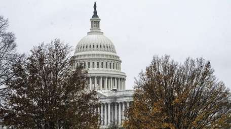Snow falls in front of the U.S. Capitol