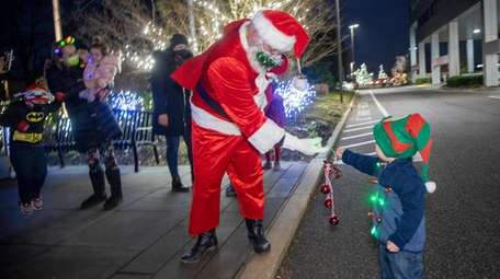 William Rockensies greets Santa as H2M employees and