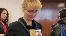 Justyna Zubko-Valva with a photo of her son