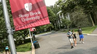 Students walk through the Stony Brook University campus