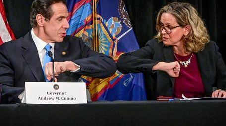 New York State Gov. Andrew M. Cuomo elbow-bumps