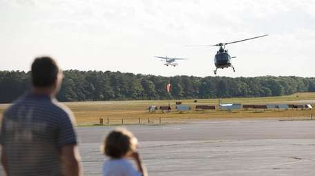 Helicopters and planes fly in and out of