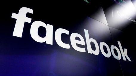 The Facebook logo on screens at the Nasdaq