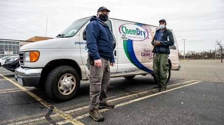 Chem-Dry owner Paul McCormack with his lead technician,