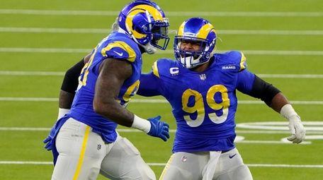 Rams defensive end Michael Brockers, left, and Aaron