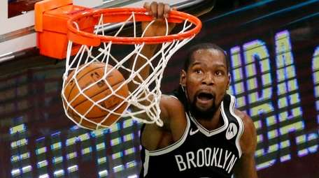 Nets forward Kevin Durant dunks during the second