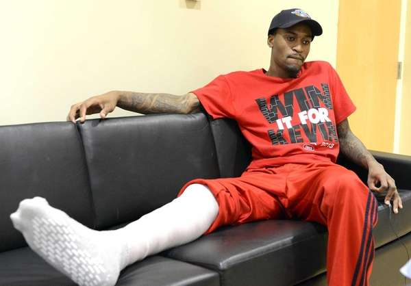 Louisville basketball player Kevin Ware answers questions during