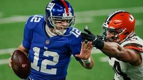 New York Giants quarterback Colt McCoy (12) evades