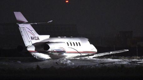 A smail jet aircraft slid off a runway