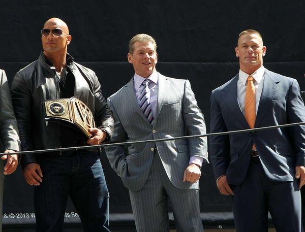 "Dwayne ""The Rock"" Johnson, left, with Vince McMahon,"