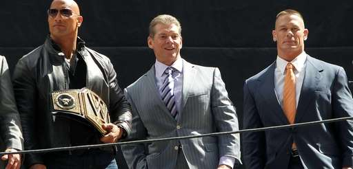 "Dwayne ""The Rock"" Johnson, left, with Vince McMahon,"