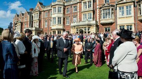 Queen Elizabeth II greets guests during a garden