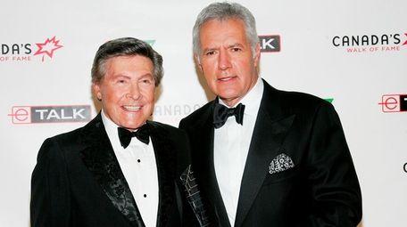"""Jeopardy!"" presenter Johnny Gilbert, left, and host Alex"