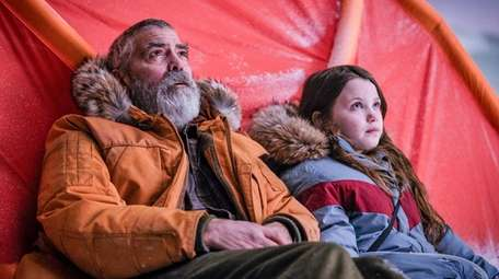 George Clooney stars with Caoilinn Springall in the