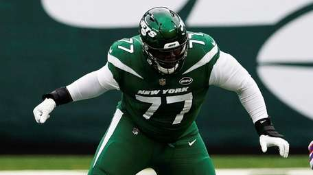 Jets offensive tackle Mekhi Becton blocks during an