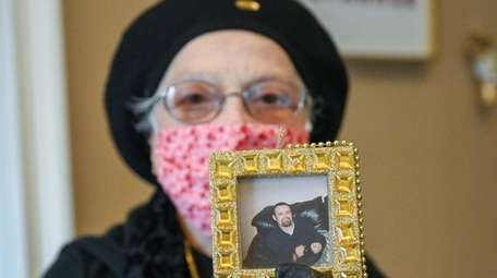 Anna Jutis shows a picture of her son