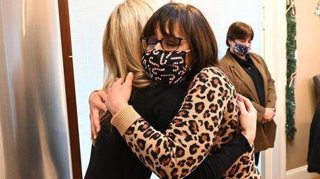 Dyan Sybalski, right, hugs Nicole Epstein, senior associate