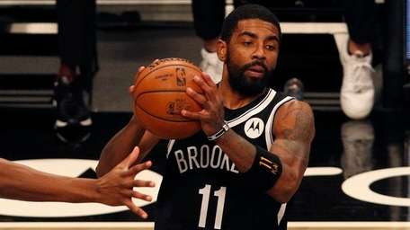 Kyrie Irving of the Nets controls the ball