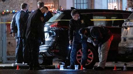 NYPD investigators at the scene in Crown Heights,