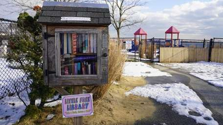 Little Free Library and playground at Hewlett Point