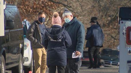 Investigators at the scene in Shirley where a