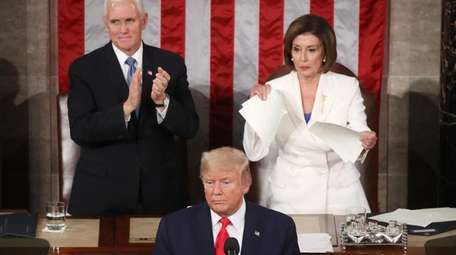 House Speaker Nancy Pelosi rips up pages of