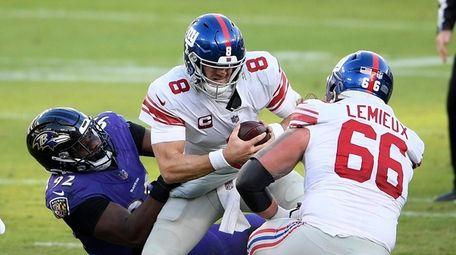 Baltimore Ravens defensive tackle Justin Madubuike, left, sacks