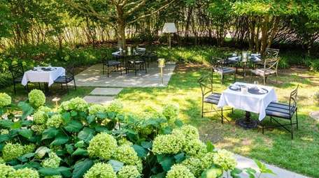 Outdoor dining space at 1770 House in East