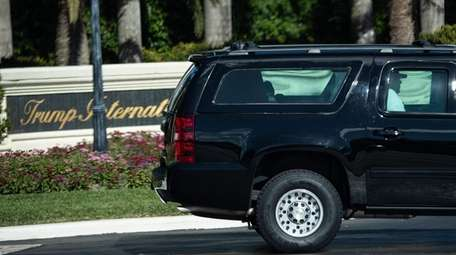 President Donald Trump leaves after playing golf Sunday