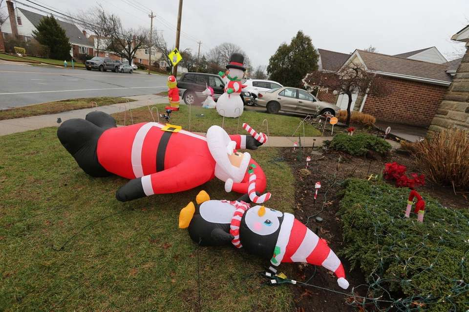 Fallen Christmas decorations on the lawn of a