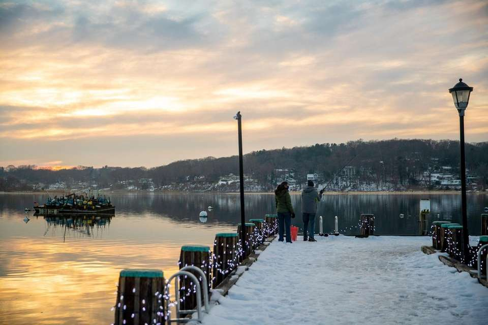 A man casts his line into Northport Harbor