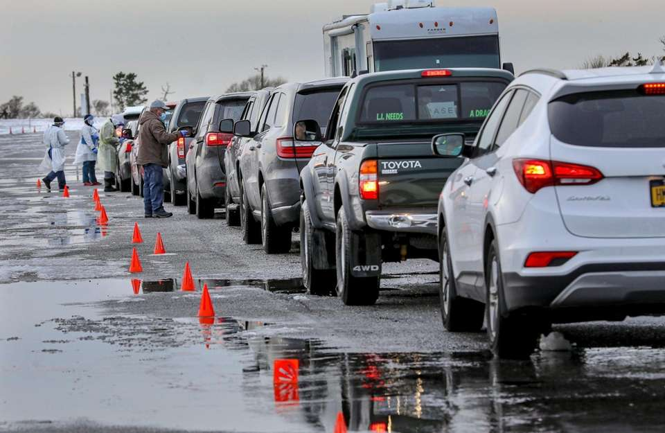 Cars line up at a drive-through COVID-19 testing