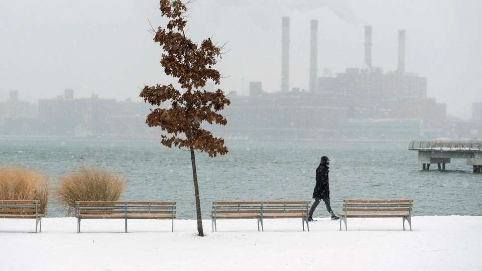Snow falls as seen in Transmitter Park in